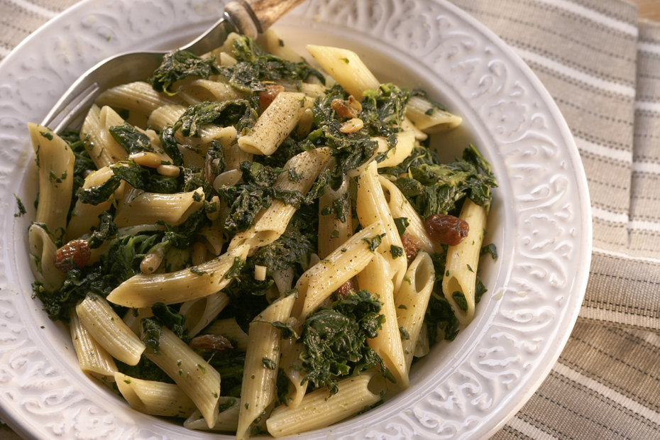 Spicy Pasta Tossed with Spinach, Pine Nuts, Raisins