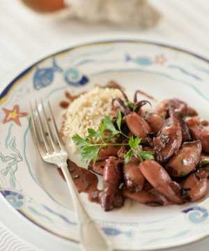 Squid stir fried with ginger, garlic, ouzo, and soy sauce.