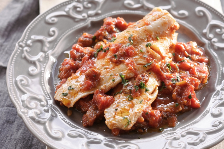 Salt Cod in light tomato sauce with spices and raisins.