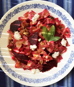 Bow-tie pasta with smoked beets, Greek cheese and walnuts