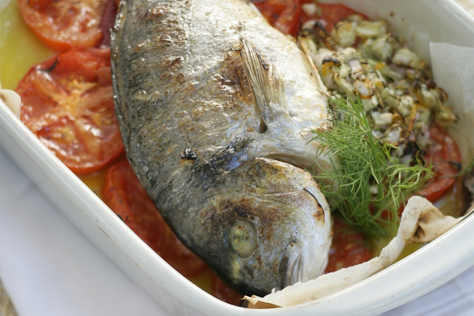 Tsipoura, or gilthead bream, roasted with tomatoes, fennel and ouzo