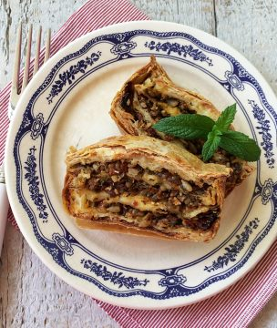 Phyllo cheese pie in a loaf pan with sundried tomatoes