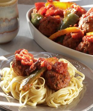 Greek meatballs cooked in tomato-pepper stew