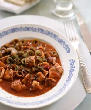 Squid cooked in tangy olive-tomato sauce.