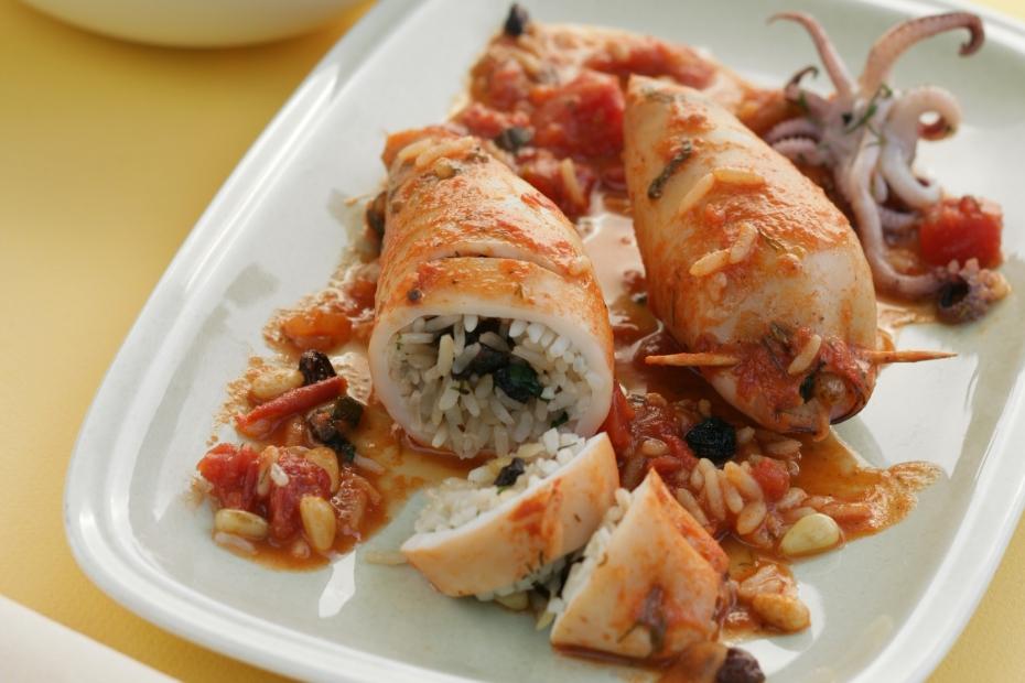 Squid, calamari, stuffed with rice, pine nuts, and raisins.
