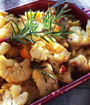Sautéed Cauliflower with Rosemary, Oranges, Cumin and Dried Tomatoes
