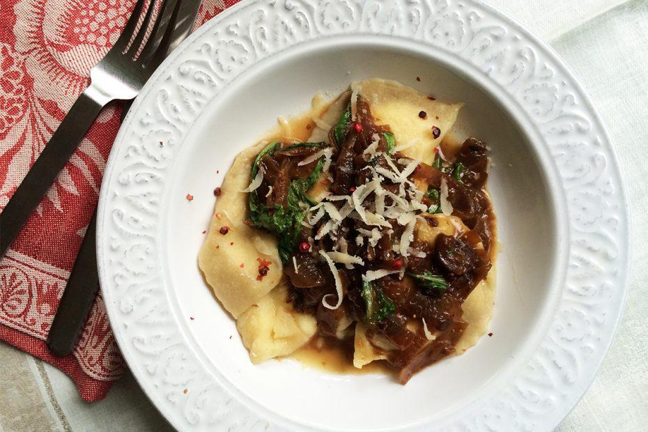 Vegetarian Greek ravioli w figs, arugula, onions