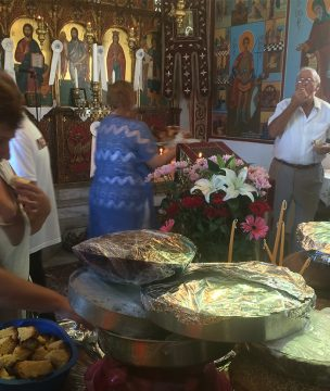 Cakes and Artos laid out at the altar on St. Fanourios Day, Aug. 27th, Ikaria.