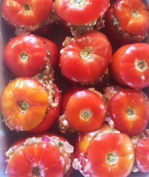 Trahana stuffed tomatoes ready for baking.