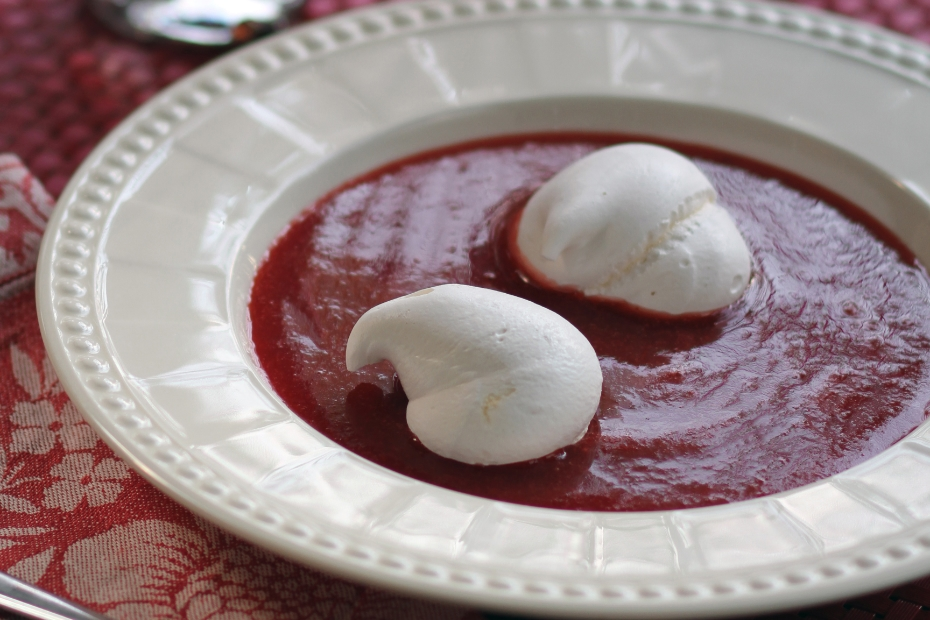 Meringues in a strawberry soup