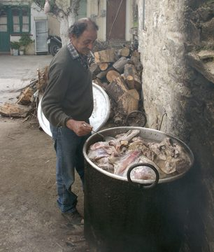 Making the Vrasto, or boiled goat, for the communal feast in our village on Ikaria.