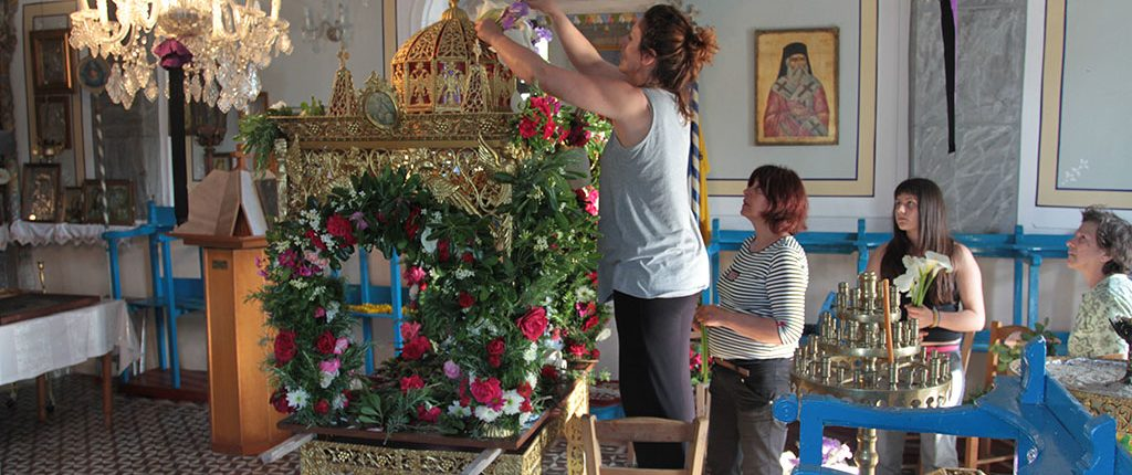 Decorating the Epitaphio on Good Friday in our village on Ikaria.