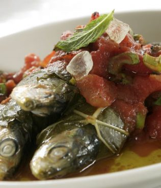 Sardines Baked in Grape Leaves with Mastiha-Tomato Sauce