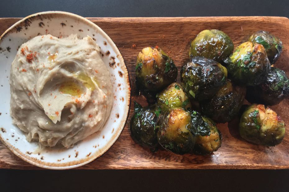 Honey-charred brussel sprouts and skordalia made with pureed chestnuts.