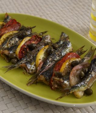 Baked Sardines with Ouzo, Tomatoes, Capers, and Lemon