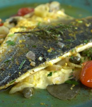 Greek Sea Bass Baked with Santorini Assyrtico Wine, Capers Leaves, and Herbs