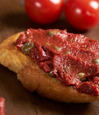 Bertes me Capari (Tomato Paste-Caper Dip) on Bruschetta