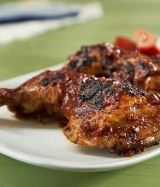 Grilled Chicken Legs with Tomato-Olive Barbecue Sauce