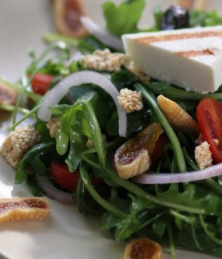 Arugula Salad with Dried Figs, Wrinkled Olives and Pasteli