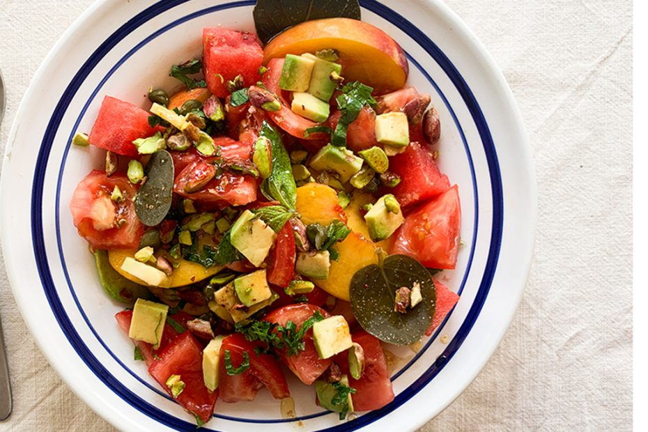 Greek salad with peaches, watermelon, tomatoes, capers and pistachios