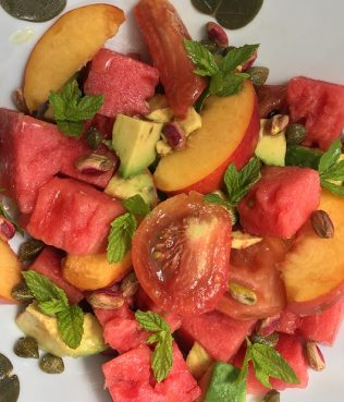Greek Salad with Heirloom Tomatoes, Santorini Capers, Aegina Pistachios, Watermelon, Peaches & Avocado