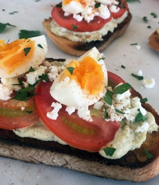 Lemon Hummus Toast With Feta & Eggs