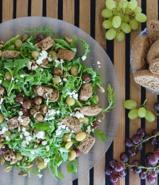 Greek Salad with Rusks, Roasted Grapes, Aegina Pistachios & Arugula