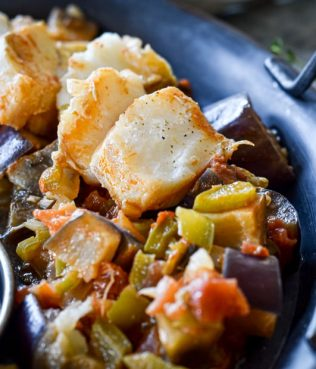Fresh Cod Fillets Stewed with Eggplants, Peppers and Wine